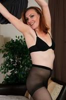 Horny Redhead Amber K Strips Naked